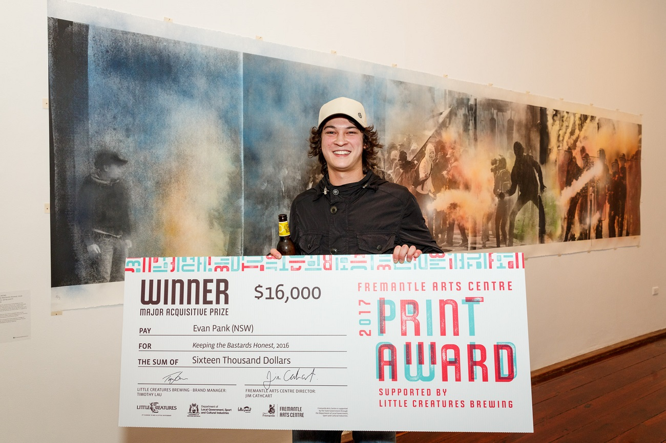 2017 FAC Print Award winner Evan Pank in front of his work Keeping the Bastards Honest. Photography by Jessica Wyld
