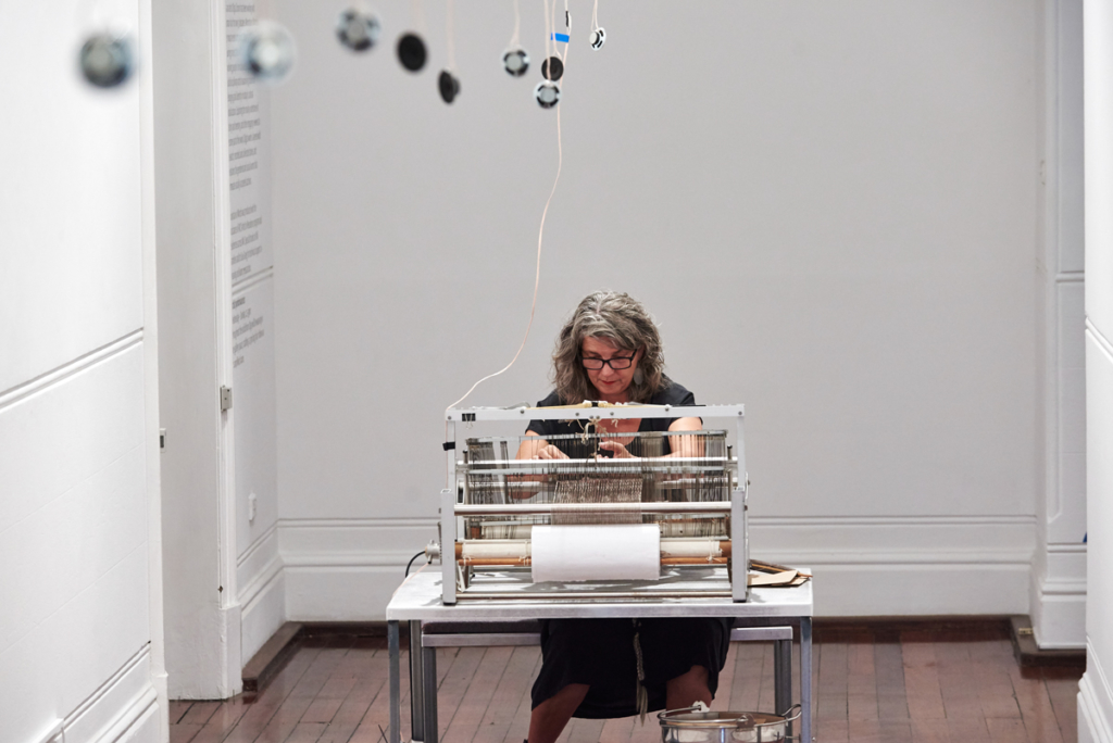Olga Cironis, Mountain of Words, 2017, metal loom, table and chair, sensors, speakers and amp, human hair, natural fibre, performance. Photo by Rebecca Mansell