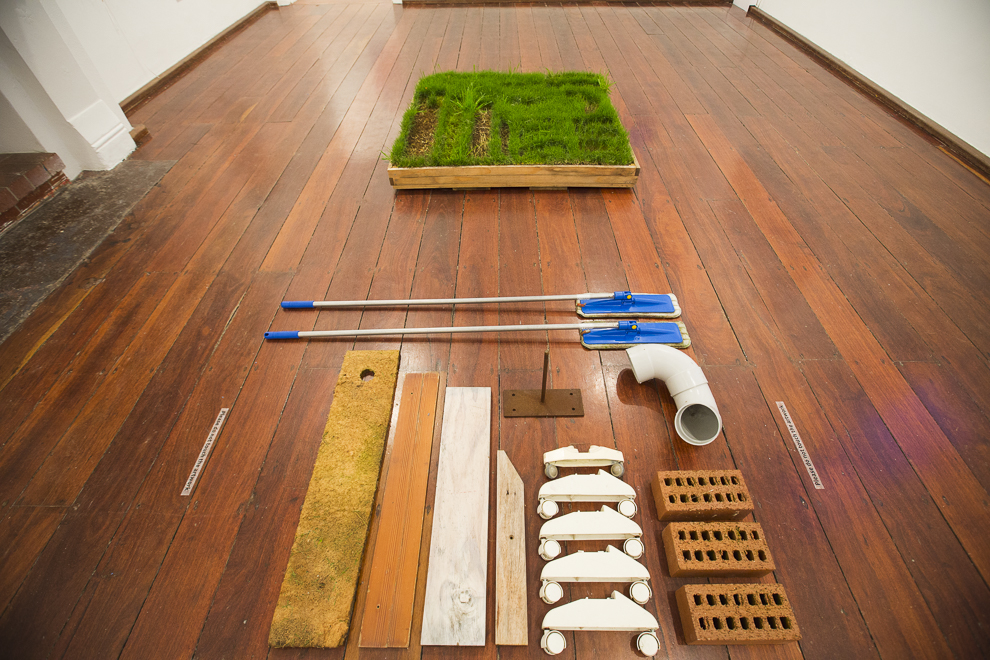 Holly O'Meehan, Arrangements of a Verge Collection, 2014, roll out turf, treated pine planter box and found objects, 120 x 290 x 15cm, 1/1