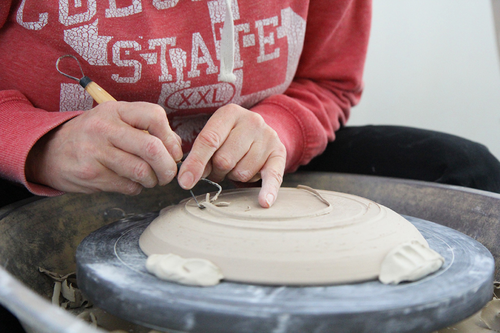 Artist in Residence Stephanie Hammill wheel throwing in FAC's Ceramic Studio