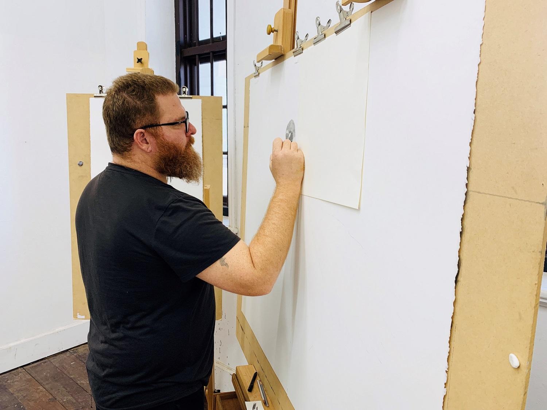 Ross Potter working in his studio